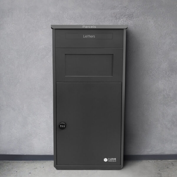 Black large parcel drop box seen in front of a grey wall