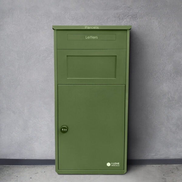 The large green parcel drop box in front of a grey wall